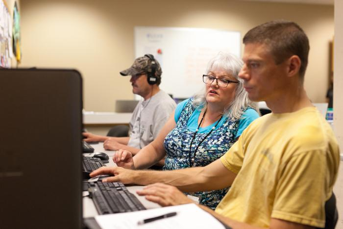 Adult learners work in computer lab